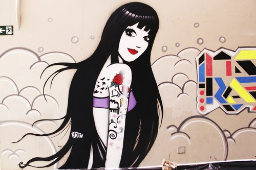 Cartoon: tattoo girl on the wall (medium) by naths tagged graffiti,tattoo,girl